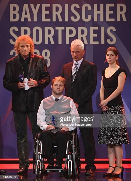 TV presenter Thomas Gottschalk poses with Award winner and former wrestler Martin Kittner during the Bavarian Sport Award 2008 at the International...
