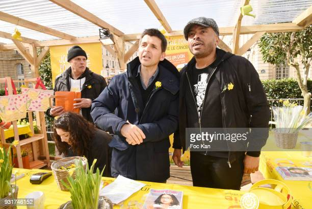 TV presenter Thomas Sotto and Ali Rebeihi from France Inter attend Une Jonquille pour Institut Marie Curie Place du Pantheon on March 13 2018 in...