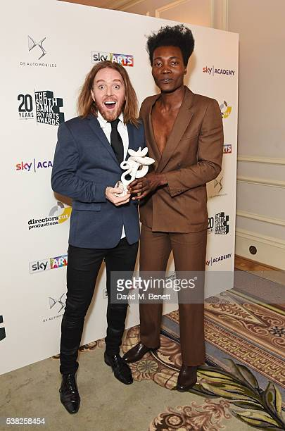 "Presenter Tim Minchin and Benjamin Clementine, winner of the Pop award for ""At Least For Now"", pose in the Winner's Room at the The South Bank Sky..."