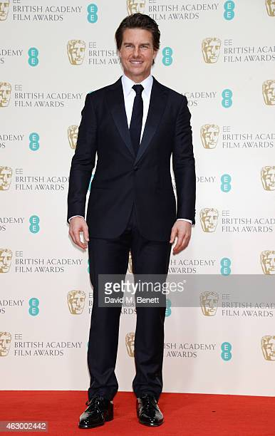 Presenter Tom Cruise poses in the winners room at the EE British Academy Film Awards at The Royal Opera House on February 8 2015 in London England