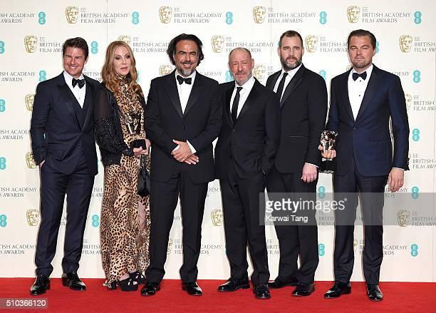 Presenter Tom Cruise poses with Best Film winners Mary Parent Alejandro Gonzalez Inarritu Steve Golin Keith Redmon and Best Actor winner Leonardo...