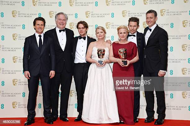 Presenter Tom Cruise poses with Jonathan Sehring Ellar Coltrane Cathleen Sutherland Patricia Arquette Ethan Hawke and John Sloss as they celebrate...
