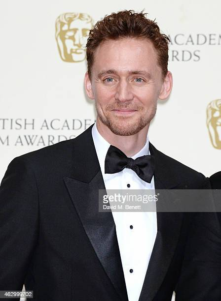 Presenter Tom Hiddleston poses in the winners room at the EE British Academy Film Awards at The Royal Opera House on February 8 2015 in London England
