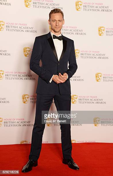 Presenter Tom Hiddleston poses in the winners room at the House Of Fraser British Academy Television Awards 2016 at the Royal Festival Hall on May 8...