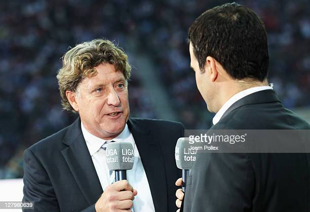 TV presenter Toni Schumacher and Oliver Schwesinger talk prior to the Bundesliga match between Hertha BSC Berlin and 1 FC Koeln at Olympic Stadium on...