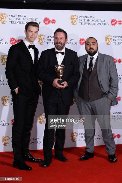 Presenter Will Poulter, winner of the Entertainment Performance award for 'Would I Lie To You?', Lee Mack and presenter Asim Chaudhry pose in the...