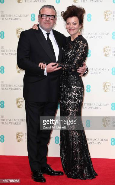 Presenters actors Ray Winstone and Helen McCrory pose in the winners room at the EE British Academy Film Awards 2014 at The Royal Opera House on...
