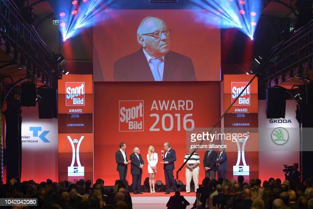 Presenters Alexander Bommes and Andrea Fischer honour the team captain of honour of the German national soccer team Uwe Seeler for his lifetime...