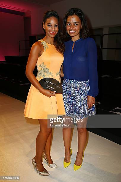 TV presenters Alicia Fall and Laurence Roustandjee attend the Danny Atrache show as part of Paris Fashion Week Haute Couture Fall/Winter 2015/2016 on...