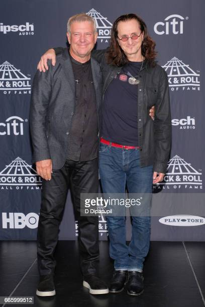 Presenters and 2013 Inductees Alex Lifeson and Geddy Lee of Rush attends the Press Room of the 32nd Annual Rock Roll Hall Of Fame Induction Ceremony...