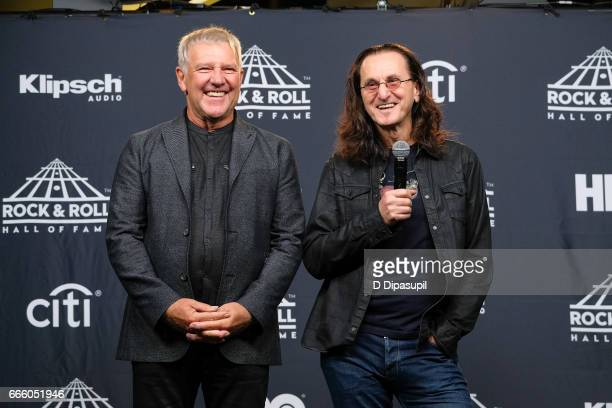 Presenters and 2013 Inductees Alex Lifeson and Geddy Lee of Rush attend the Press Room of the 32nd Annual Rock Roll Hall of Fame Induction Ceremony...
