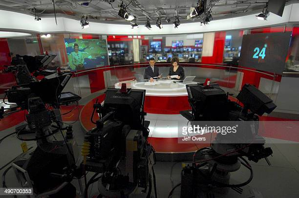 Presenters and newsreaders Jane Hill and Matthew Amroliwala on the set of BBC News 24 in Stage VI Television Centre