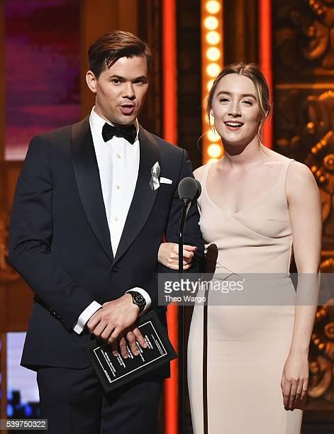 Presenters Andrew Rannells and Saoirse Ronan speak onstage during the 70th Annual Tony Awards at The Beacon Theatre on June 12 2016 in New York City