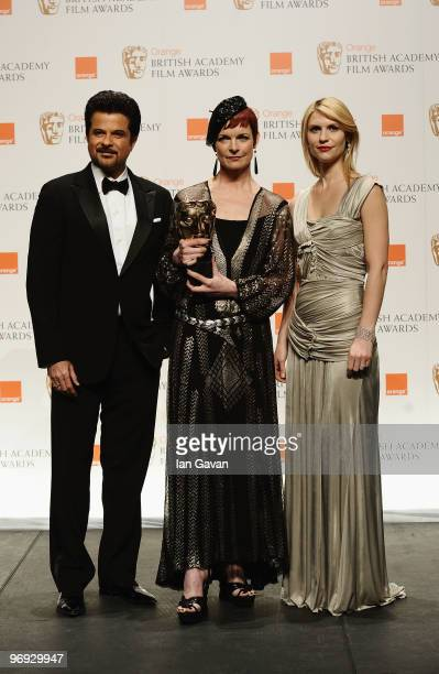 Presenters Anil Kapoor and Claire Danes pose with winner Sandy Powell for Best Costume for the film The Young Victoria during Orange British Academy...
