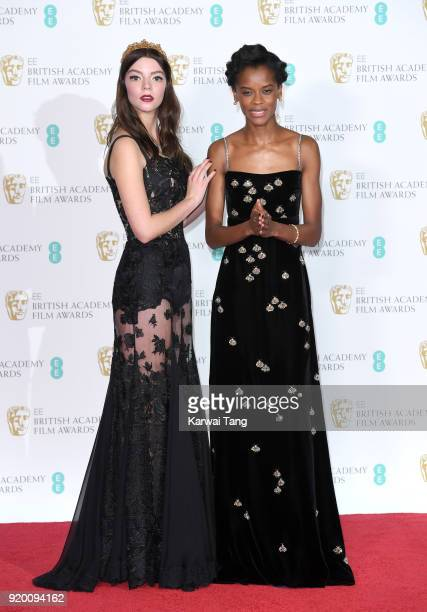 Presenters Anya TaylorJoy and Letitia Wright pose in the press room during the EE British Academy Film Awards held at the Royal Albert Hall on...