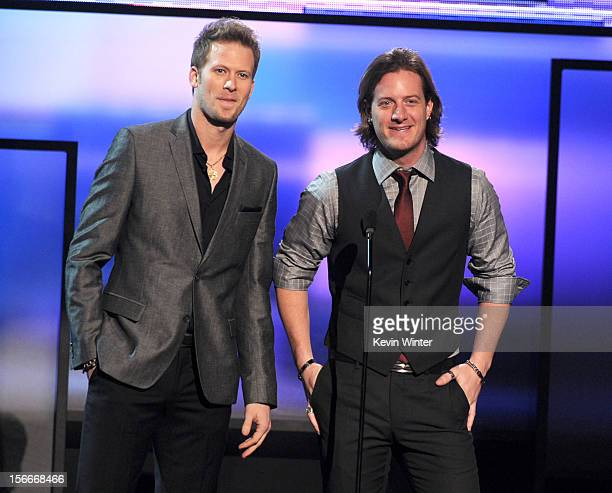 Presenters Brian Kelly and Tyler Hubbard of Florida Georgia Line speak onstage during the 40th American Music Awards held at Nokia Theatre LA Live on...