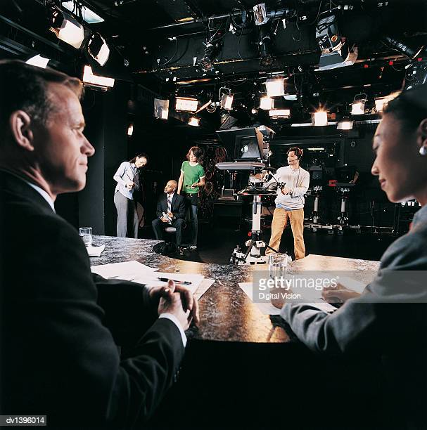 TV Presenters, Cameraman and Behind the Scenes Crew in a TV Studio