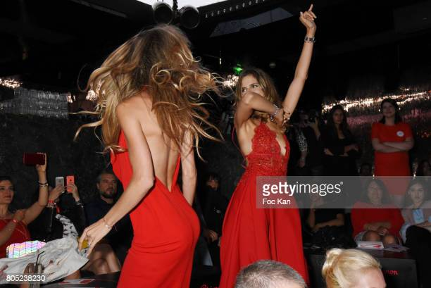 TV presenters Candice De Saint Pern by Pierre Cardin and Margaux De Frouville by Laura Laval walk the runway during the 'Red Defile' Auction Fashion...
