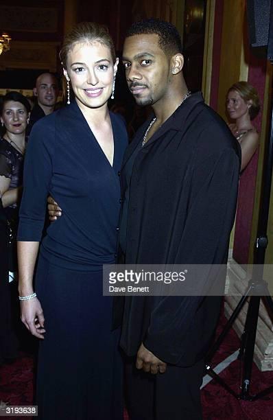 Presenter's Cat Deeley and Richard Blackwood arrive at the BAFTA'S 2002 in Drury Lane on April 21st, 2002 in London.