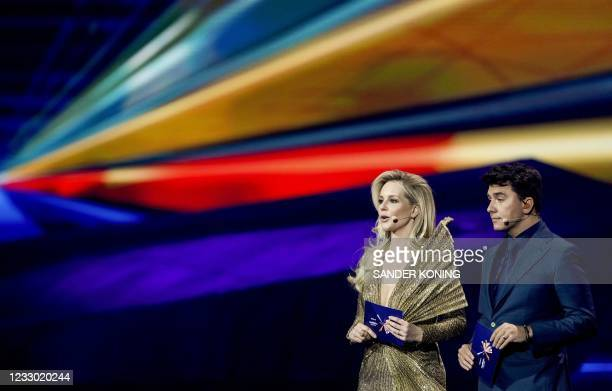 Presenters Chantal Janzen and Jan Smit speak during the dress rehearsal of the final of the Eurovision Song Contest in Rotterdam, on May 21, 2021. -...