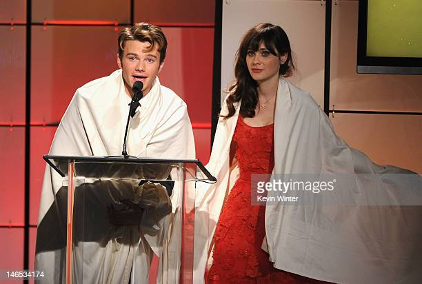 Presenters Chris Colfer and Zooey Deschanel onstage during The Broadcast Television Journalists Association Second Annual Critics' Choice Awards at...