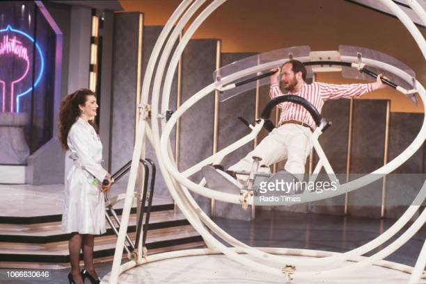 Presenters Cleo Rocos and Kenny Everett demonstrating a piece of equipment on the BBC television show 'Brainstorm' January 5th 1988