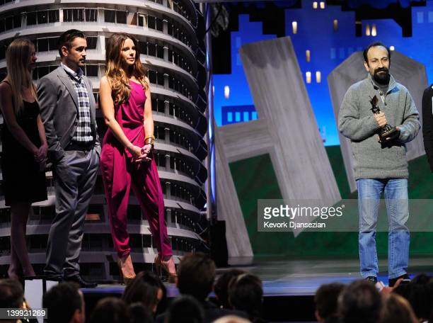 Presenters Colin Farrell and Kate Beckinsale and winner of the Best International award for 'A Separation' director Asghar Farhadi onstage at the...