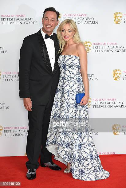 Presenters Craig Revel Horwood and Helen George pose in the winners room at the House Of Fraser British Academy Television Awards 2016 at the Royal...