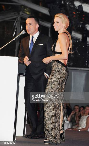 Presenters David Furnish and Naomi Watts pose at the Glamour Women of the Year Awards in association with Pandora at Berkeley Square Gardens on May...