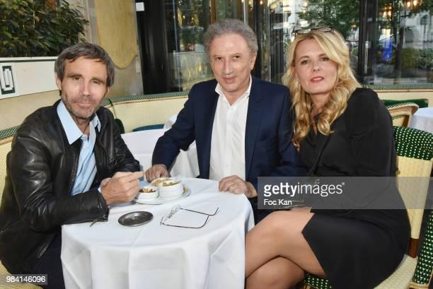 TV presenters David Pujadas Michel Drucker and PR Carole Fernandez attend 'L'Ete Litteraire Des Deux Magots ' Book Signing Cocktail at Les Deux...