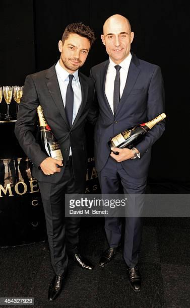 Presenters Dominic Cooper and Mark Strong pose backstage at the Moet British Independent Film Awards 2013 at Old Billingsgate Market on December 8...