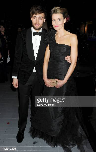 Presenters Douglas Booth and Natascha McElhone pose in the press room at the 2012 Olivier Awards held at The Royal Opera House on April 15 2012 in...