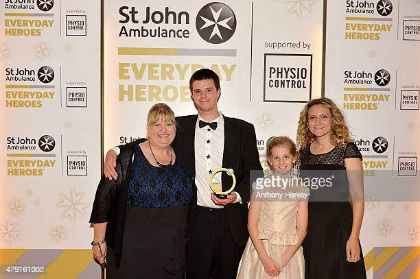 Presenters Dr Ellie Cannon and Beth ChesneyEvans pose with Max Willson winner of the Guy Evans Young Hero Award as they attend the St John...