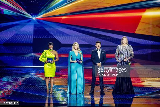 Presenters Edsilia Rombley, Chantal Jansen, Jan Smit and Nikki de Jager stand on stage during the first dress rehearsal of the second semi-final of...