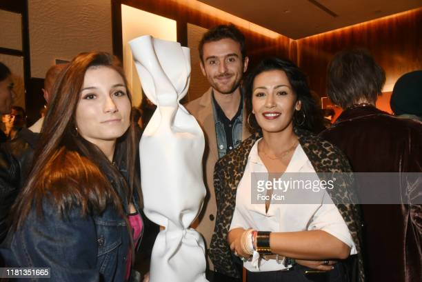TV presenters Emmy Labaigs Karima Charni and Christopher Quarez from La Matinale Week End LCI attend GV Monumental Exhibition Preview Avenue Georges...