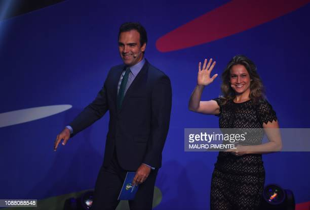 Presenters Fernanda Gentili and Tadeu Schmidt get on the stage to present the draw of the 2019 Copa America football tournament, in Rio de Janeiro,...