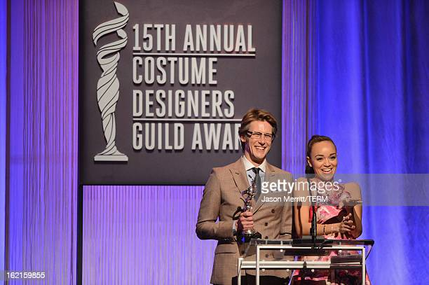 Presenters Gabriel Mann and Ashley Madekwe onstage during the 15th Annual Costume Designers Guild Awards with presenting sponsor Lacoste at The...
