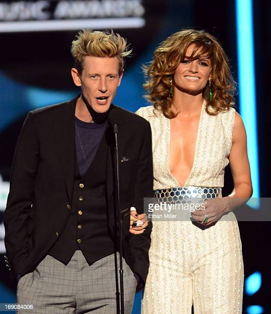 Presenters Gabriel Mann and Stana Katic speak onstage during the 2013 Billboard Music Awards at the MGM Grand Garden Arena on May 19 2013 in Las...