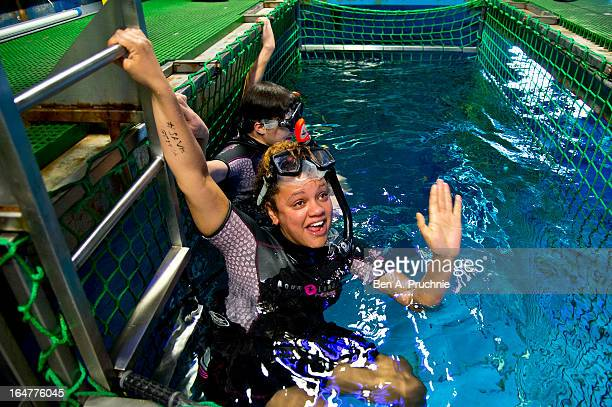 Presenters Gemma Cairney and Georgie Okell snorkel with sharks whilst filming The Fox Problem for Google at The SEA LIFE London Aquarium on March 28...