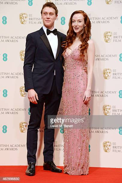 Presenters George MacKay and Olivia Grant pose in the winners room at the EE British Academy Film Awards at The Royal Opera House on February 8 2015...