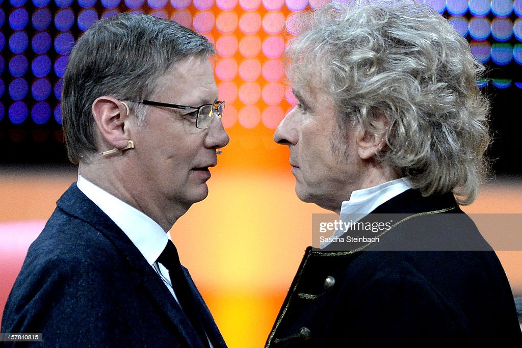 Presenters Guenther Jauch and Thomas Gottschalk face each other during the taping of the anniversary show '30 Jahre RTL - Die grosse Jubilaeumsshow mit Thomas Gottschalk' on December 18, 2013 in Huerth, Germany.