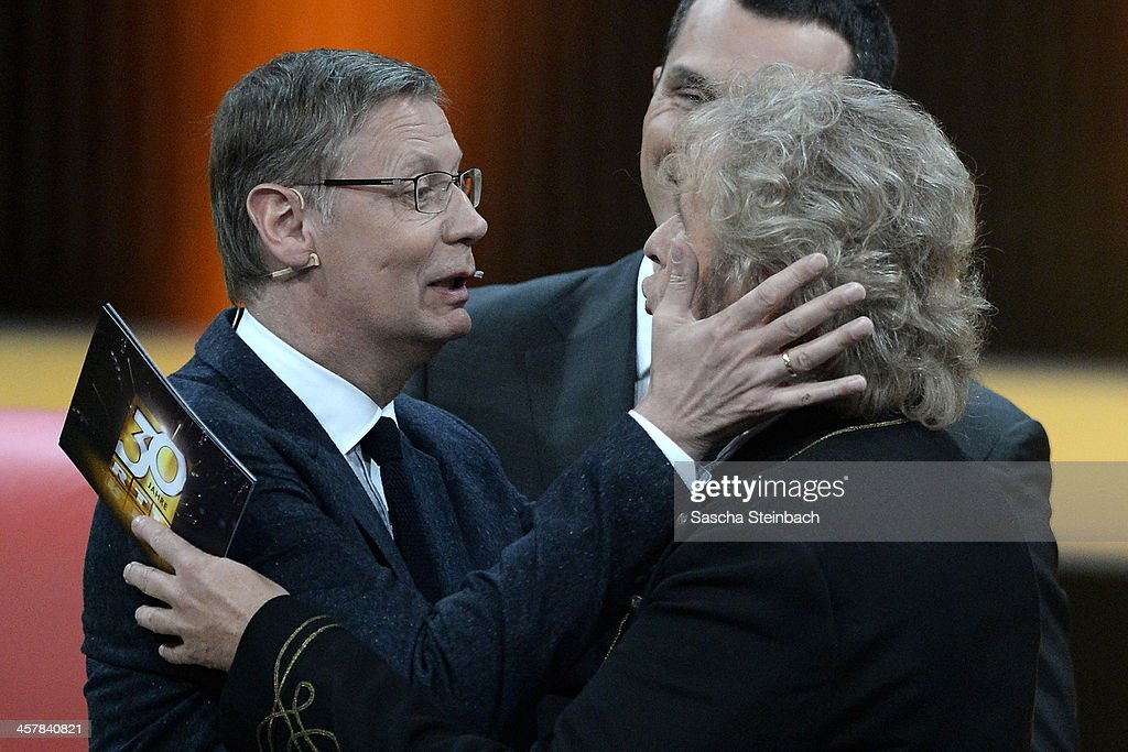 Presenters Guenther Jauch and Thomas Gottschalk try to kiss each other during the taping of the anniversary show '30 Jahre RTL - Die grosse Jubilaeumsshow mit Thomas Gottschalk' on December 18, 2013 in Huerth, Germany.