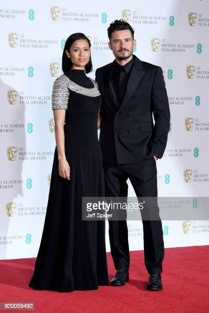 Presenters Gugu MbathaRaw and Orlando Bloom pose in the press room during the EE British Academy Film Awards held at Royal Albert Hall on February 18...