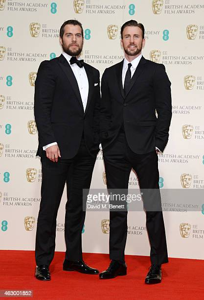 Presenters Henry Cavill and Chris Evans pose in the winners room at the EE British Academy Film Awards at The Royal Opera House on February 8 2015 in...