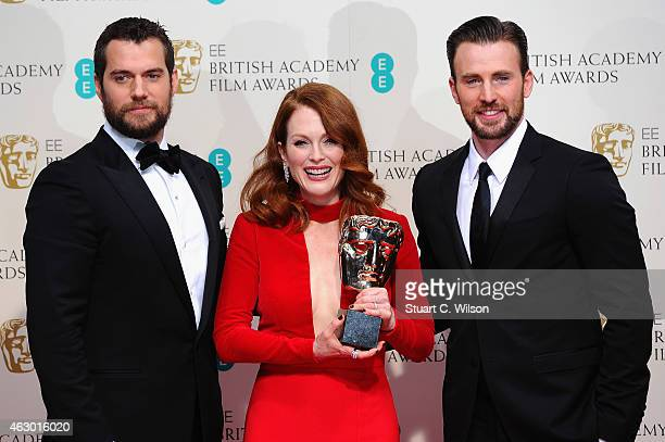 Presenters Henry Cavill Chris Evans and actress Julianne Moore winner of the Best Leading Actress award for the movie 'Still Alive' poses in the...