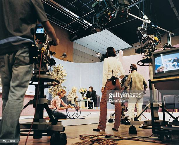TV Presenters in a TV Studio With Producers and TV Cameramen