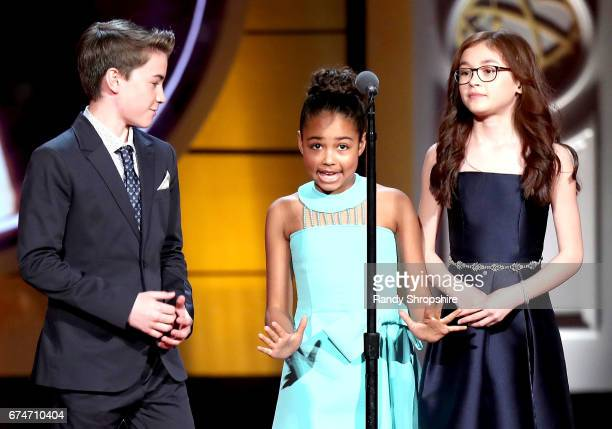 Presenters Isaac Kargten Millie Davis and Anna Cathcart attend the 44th annual daytime creative arts Emmy awards show at Pasadena Civic Auditorium on...