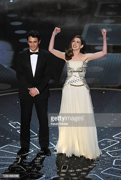 Presenters James Franco and Anne Hathaway speak onstage during the 83rd Annual Academy Awards held at the Kodak Theatre on February 27 2011 in...
