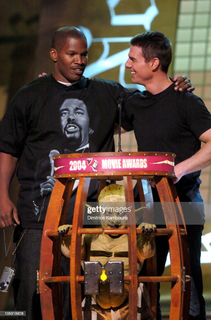 Presenters Jamie Foxx and Tom Cruise during MTV Movie Awards 2004 - Show at Sony Pictures Studios in Culver City, California, United States.