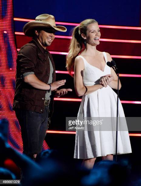 Presenters Jason Aldean and Brooklyn Decker speak at the 2014 CMT Music awards show at the Bridgestone Arena on June 4 2014 in Nashville Tennessee